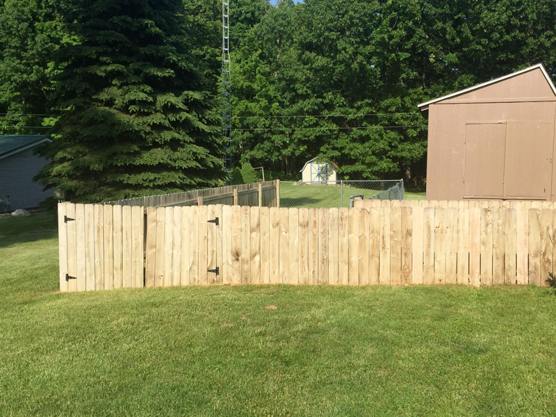 tree frog softwash performs fence cleaning job on this wood fence near fort wayne, in